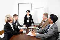Multiethnic businesspeople at meeting in conference room
