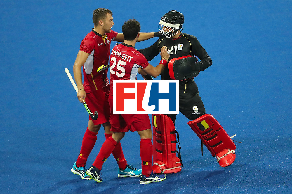 RIO DE JANEIRO, BRAZIL - AUGUST 09:  Alexander Hendrickx #16, Loick Luypaert #25 and goalkeeper Vincent Vanasch #21 of Belgium celebrate after defeating Australia 1-0 in the hockey game on Day 4 of the Rio 2016 Olympic Games at the Olympic Hockey Centre on August 9, 2016 in Rio de Janeiro, Brazil.  (Photo by Christian Petersen/Getty Images)