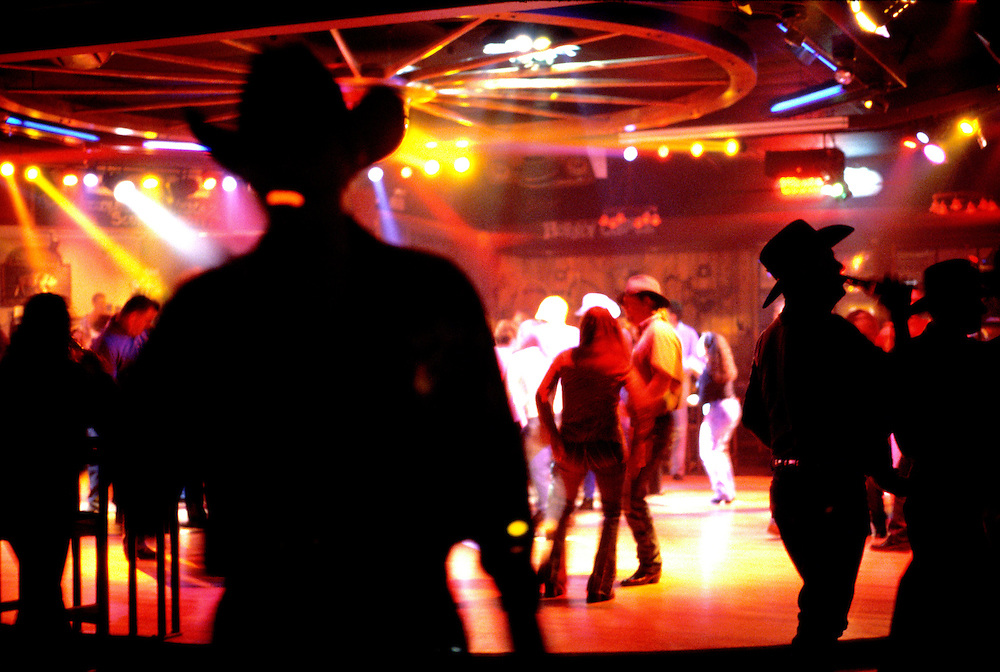 """Ladies night"" at the wagon Wheel, Austin,Texas, USA..Honky Tonks are dancehalls in Texas, men and women come to dance, drink socialise in a dancehall, in Austin, Texas called the wagon Wheel. The dance the Two Step on a large wooden dance floor to Country and Western music, sometimes played by a band. The men wear clean pressed blue jeans and starched shirts and boots, topped off by cowboy hats......© Neville Elder.."