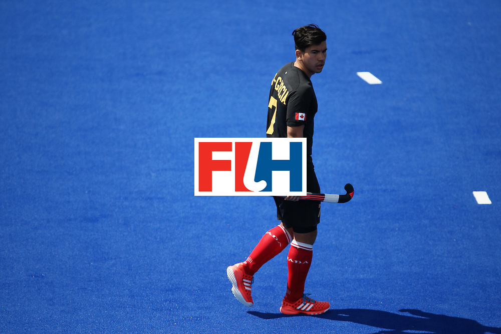 RIO DE JANEIRO, BRAZIL - AUGUST 11:  Gabriel Ho-Garcia #7 of Canada walks downfield against India during a Men's Preliminary Pool B match on Day 6 of the Rio 2016 Olympics at the Olympic Hockey Centre on August 11, 2016 in Rio de Janeiro, Brazil.  (Photo by Sean M. Haffey/Getty Images)