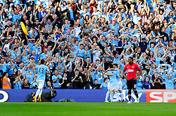 Manchester City's Sergio Aguero celebrates his goal - Photo mandatory by-line: Dougie Allward/JMP - Tel: Mobile: 07966 386802 22/09/2013 - SPORT - FOOTBALL - City of Manchester Stadium - Manchester - Manchester City V Manchester United - Barclays Premier League