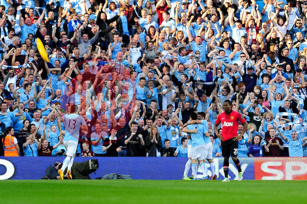 Manchester City's Sergio Aguero celebrates his goal - Photo mandatory by-line: Dougie Allward/JMP - Tel: Mobile: 07966 386802 22/09/2013 - SPORT - FOOTBALL - City of Manchester Stadium - Manchester - Manchester City V Manchester United - Barclays Premier League