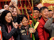 People watch lion dancers performing at the Thien Hau temple to celebrate the first day of the Chinese Lunar New Year, the Year of the Dog, on Friday February 16, 2018, in Los Angeles, the United States. (Xinhua/Zhao Hanrong)<br /> 2月16日,农历正月初一凌晨,在美国洛杉矶,大批华人涌入中国城天后宫庙上香祈福。图为民众在庙內观赏舞狮。。新华社发 (赵汉荣摄) (Photo by Ringo Chiu)<br /> <br /> Usage Notes: This content is intended for editorial use only. For other uses, additional clearances may be required.