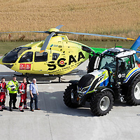 SCAA…Scotland's Charity Air Ambulance 'Helimed 76' pictured with Police Scotland's tractor ahead of the Perth Show on the 4/5th August…The tractor has been loaned to Police Scotland Specialist Crime Division who are responsible for rural and agricultural crimes, pictured from left Brian Hamilton from Reekie's, paramedic Darren O'Brien, PC Frank Donald Police Scotland Roads Policing Unit and paramedic Rich Garside and PC Willie Johnstone Police Scotland Specialist Crime Division<br />