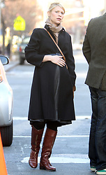 Heavy pregnant actress Claire Danes with her husband actor Hugh Dancy hail a cab on Sixth Avenue in Soho, New York City, NY, USA on December 11, 2012. The couple reportedly expecting a baby girl early next year. Photo by Charles Guerin/ABACAPRESS.COM  | 345395_007