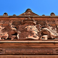 Coat of Arms Anomaly in Malmö, Sweden<br /> Most of the Centralposthuset's façade is red brick with few decorations except for this relief of the Kingdom of Sweden's coat of arms. At first glance, it appears to be the greater version without the ermine mantling. Upon closer inspection, the two lions regardant are facing the wrong direction. They normally look away from the shield. It is not clear whether this anomaly was intentional or a mistake.