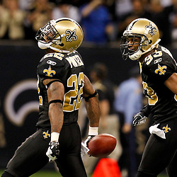 December 4, 2011; New Orleans, LA, USA; New Orleans Saints cornerback Tracy Porter (22) celebrates with teammate cornerback Jabari Greer (33) following an interception against the Detroit Lions during the second half of a game at the Mercedes-Benz Superdome. The Saints defeated the Lions 31-17. Mandatory Credit: Derick E. Hingle-US PRESSWIRE
