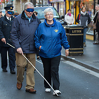 Fr Tom Hogan assisted by Lena O'Rourke of Seeking Vision Clare in the 'Walk a mile for the Blind' in Ennis