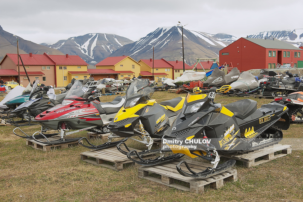 LONGYEARBYEN, NORWAY - SEPTEMBER 01, 2011: View to the snowmobiles parked outside for a short arctic summer in Longyearbyen, Norway.