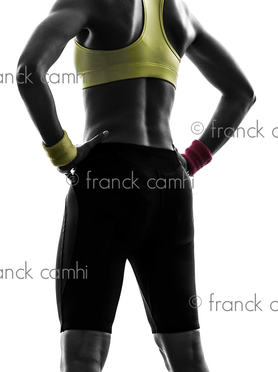close up buttocks rear view one woman back exercising fitness workout in silhouette on white background