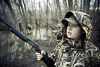 YOUNG GIRL DUCK HUNTER WEARING REALTREE MAX-4 CAMOUFLAGE AND HOLDING A ROSSI SINGLE SHOT 20 GAUGE SHOTGUN