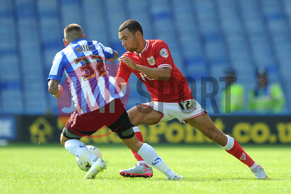 Ryan Fredericks of Bristol City jostles for the ball with Jack Hunt of Sheffield Wednesday - Mandatory byline: Dougie Allward/JMP - 07966386802 - 08/08/2015 - FOOTBALL - Hillsborough Stadium -Sheffield,England - Sheffield Wednesday v Bristol City - Sky Bet Championship