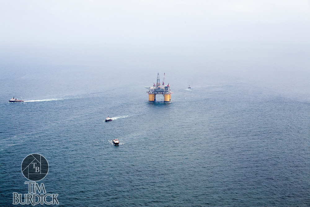 "Offshore Oil platform ""OLYMPUS"" being positioned off the coast of Louisiana in the Gulf of Mexico by Crowley Maritime Corporation's OCEAN CLASS Tugs. (Aerial Photography by Tim Burdick)"