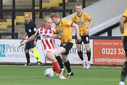 Ryan Broom and  Brad Halliday during the EFL Sky Bet League 2 match between Cambridge United and Cheltenham Town at the Cambs Glass Stadium, Cambridge, England on 25 August 2018.
