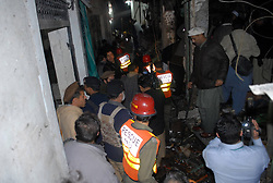 61017755<br /> People and rescuers work at the blast site in northwest Pakistan s Peshawar on Feb. 4, 2014 At least eight people were killed and 25 others injured on Tuesday evening as a blast hit a busy market in Peshawar, local media reported, Tuesday, 4th February 2014. Picture by  imago / i-Images<br /> UK ONLY