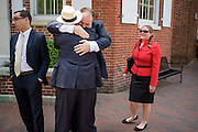 Annapolis, Maryland - May 12, 2015: <br /> Luke Clippinger, Maryland delegate for district 46, and sponsor of the community solar bill, hugs ___ after a lunch celebrating the bill's signing in Annapolis Tuesday May 12, 2015.<br /> <br /> Robin Dutta, representative for Maryland DC Virginia Solar energy industries association (MDV-SEIA), is on the left, and Jessica Ennis, Earthjustice legislative representative, is on the right.<br /> <br /> CREDIT: Matt Roth for Earthjustice