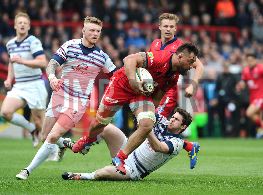 Rotherham Fly-Half Tom Barrett attempts to stop Bristol Flanker Jack Lam  - Photo mandatory by-line: Joe Meredith/JMP - Mobile: 07966 386802 - 02/05/2015 - SPORT - Rugby - Bristol - Ashton Gate - Bristol Rugby v Rotherham - Greene King IPA Championship