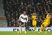 Fulham striker Ryan Babel (12) takes on Brighton and Hove Albion defender Gaetan Bong (3) during the Premier League match between Fulham and Brighton and Hove Albion at Craven Cottage, London, England on 29 January 2019.