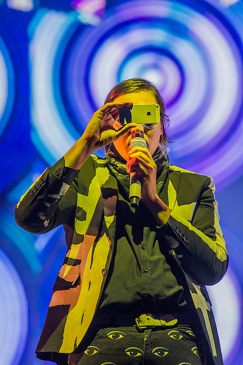 Arcade Fire play the pyramid stage.  Lead singer Win Butler borrows an iphone from a fan and then a camera from a photographer to shoot images of the crowd. The 2014 Glastonbury Festival, Worthy Farm, Glastonbury. 27 June 2013.  Guy Bell, 07771 786236, guy@gbphotos.com