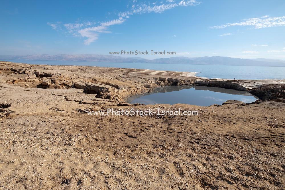 Israel, Dead Sea A sinkhole caused by the receding water level of the Dead Sea. A hot water spring fills the hole