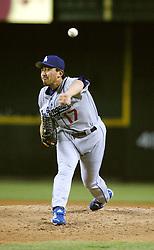 Phoenix, AZ 06-04-04 L.A.Dodgers pitcher Kazuhisa Ishii throws in the 2nd inning against the Arizona Diamondbacks. Ishii pitched 5 innings with 4 hits and 3 runs. The Dodgers won 7-3. Ross Mason photo