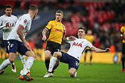 Scot Bennett of Newport County is tackled by Juan Foyth of Tottenham Hotspur during the The FA Cup fourth round replay match between Tottenham Hotspur and Newport County at Wembley Stadium, London, England on 6 February 2018. Picture by Toyin Oshodi.