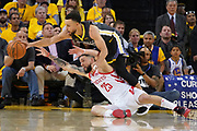 April 30, 2019; Oakland, CA, USA; Golden State Warriors guard Stephen Curry (30) and Houston Rockets guard Austin Rivers (25) fight for a loose ball during the fourth quarter in game two of the second round of the 2019 NBA Playoffs at Oracle Arena. The Warriors defeated the Rockets 115-109.