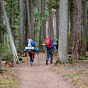 Shannon Mahre (L) and Andy Mahre (R) hiking the Sperry Trail for a ski mission.