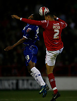 Photo: Richard Lane/Richard Lane Photography. Nottingham Forest v Birmingham City. Coca Cola Championship. 08/11/2008. Kelvin Wilson (R) gets his head to the ball behind Marcus Bent (L)