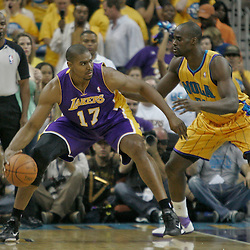 April 22, 2011; New Orleans, LA, USA; Los Angeles Lakers center Andrew Bynum (17) is guarded by New Orleans Hornets center Emeka Okafor (50) during the first quarter in game three of the first round of the 2011 NBA playoffs at the New Orleans Arena.    Mandatory Credit: Derick E. Hingle