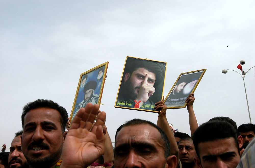 Thousands of supporters of Shia leader Moktada al-Sadr and his organization al-Hawsa pray in front of the headquarters of the US civilian administration in Iraq to protest the decison to close the oraganization's newspaper al-Hawsa Anatika for inciting violence.  .Baghdad, Iraq. 02/04/2004.Photo © J.B. Russell