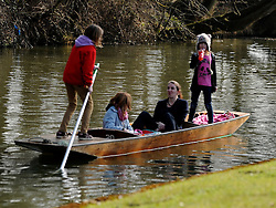 © Licensed to London News Pictures. 11/03/2012. Oxford, UK. A young family enjoy a punt ride. People enjoy the early morning sunshine on the River Cherwell in Oxford today 11 March 2012. Photo credit : Stephen SImpson/LNP