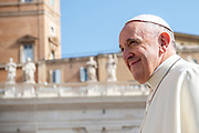 Pope Francis smiling to faithful as he arrives for his weekly general audience in St Peter's square at the Vatican on April 25, 2018.
