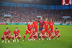BUDAPEST, HUNGARY - Tuesday, June 11, 2019: Wales' Chris Gunter is the first to break the group as the players line-up for a team group photograph before the UEFA Euro 2020 Qualifying Group E match between Hungary and Wales at the Ferencváros Stadion. Back row L-R: captain Ashley Williams, goalkeeper Wayne Hennessey, James Lawrence, Ethan Ampadu. Front row L-R: Gareth Bale, David Brooks, Chris Gunter, Tom Lawrence, Ben Davies, Joe Allen, Daniel James. (Pic by David Rawcliffe/Propaganda)