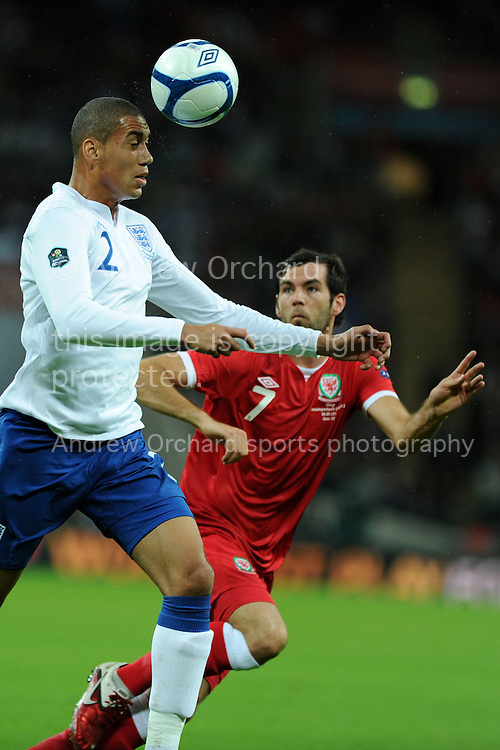 Chris Smalling of England is challenged by Joe Ledley of Wales.  Euro 2012 Qualifying match, England v Wales at Wembley Stadium in London, England on Tuesday 6th Sept 2011. Pic By  Andrew Orchard, Andrew Orchard sports photography,