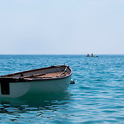 Fishing is still a way of life in the Cinque Terre region of Italy. Local fisherman anchor their fishing or row boats a few feet off shore and kayakers can be seen out in the distance paddling through the Tyrrhenian Sea.