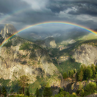 Full rainbow over Half Dome, Vernal Falls, and Nevada Falls.