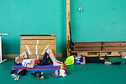 Exhausted cyclists take a rest in a school house at the Paris Brest Paris Endurance Event - Paris - France