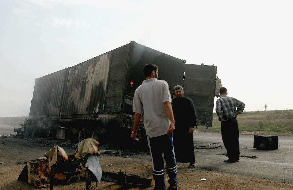 An american convoy of seven trucks transporting armoured vehicles and containers was destroyed by insurgents 40 Kms south of Baghdad..Latifiya, Iraq. 12/04/2004.Photo © J.B. Russell