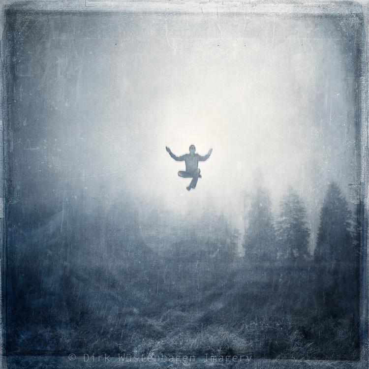 man hovering over a foggy landscape