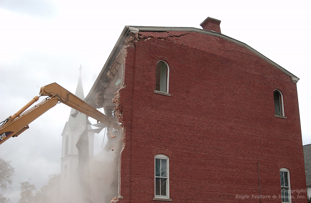 The final setion of roof and part of the last full wall comes down during the demolition of the former Holy Childhood of Jesus boarding school building.
