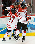 Canada's Sidney Crosby celebrates with Scott Niedermayer and Drew Doughty after scoring the game-winning overtime goal to lead Team Canada pas the U.S. 3-2 to win the Gold Medal in men's hockey at the 2010 Olympic Winter Games in Vancouver, BC.