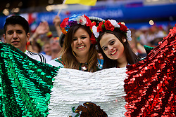 MOSCOW, RUSSIA - Sunday, June 17, 2018: Two female Mexico supporters and a sequinned national flag during the FIFA World Cup Russia 2018 Group F match between Germany and Mexico at the Luzhniki Stadium. (Pic by David Rawcliffe/Propaganda)