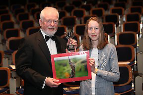 .PRESS RELEASE FROM MENTAL HEALTH IRELAND...CORK STUDENT  RUNNER-UP IN .NATIONAL  PHOTOGRAPHIC PROJECT.. .Gillian Sherwood, a student from Loreto Secondary School, Fermoy, Co Cork was declared runner-up of Mental Health Ireland's national photographic project at a ceremony in Trinity College, Dublin, on Saturday (April 9th, 2011).. ..Pictured was Mental Health Ireland, Chief Executive Officer, Brian Howard with Gillian Sherwood, Loreto Secondary School, College Road., Fermoy, Co. Cork. ..Gillian's design, was chosen from entries received from second-level students from all over Ireland. The theme of the Project was Positive Mental Health. Gillian was presented with her award, a trophy, by Mr Michael Hughes, Chairman of Mental Health Ireland.  ..Gillian's photograph shows a little ladybird climbing up a much bigger leaf.  The caption on it reads ?Your Attitude Will Determine How High You Can Climb in Life?.  Thérèse Coveney of Mental Health Ireland said ?The judges loved Gillian's photograph. The message in it is very simple. A positive attitude can make large obstacles seem much more manageable. This depicts Positive Mental Health in a very natural, effective way?...The winner of the 2010-2011 National Public Speaking event, which drew nearly 200 entries from schools and colleges nationwide, was also decided on Saturday night. This year's winning team is from Summerhill College, College Rd., Sligo who faced teams from Athlone Community College, Athlone, Co. Westmeath and Coláiste Eoin, Hacketstown, Co. Carlow in the national finals.. .- ENDS -. Note to Editors: Mental Health Ireland is a national voluntary organisation which aims to promote positive mental health and to actively support persons with a mental illness, their families and carers by identifying their needs and advocating their rights. A nationwide network of Mental Health Associations (MHAs) are affiliated to MHI and share the same aims and objectives.. For more information, please contact Mental Health