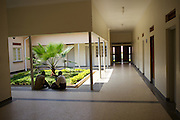 A patient and visitor sit inside the new psychiatric ward building at Mbarara Hospital in Uganda.