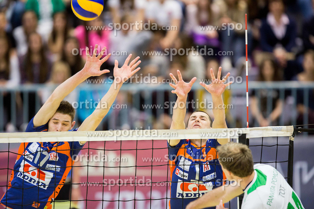 Mario Koncilja of ACH and Andrej Flajs of ACH vs Andrej Tot of Panvita Pomgrad during volleyball game between OK Panvita Pomgrad and ACH Volley in Final of 1st DOL Slovenian National Championship 2014, on April 15, 2014 in Murska Sobota, Slovenia. Photo by Vid Ponikvar / Sportida