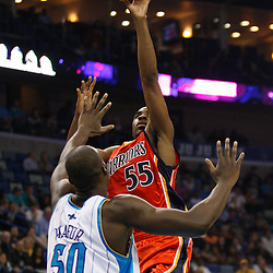 Mar 08, 2010; New Orleans, LA, USA; Golden State Warriors forward Reggie Williams (55) shoots over New Orleans Hornets center Emeka Okafor (50)during the first half at the New Orleans Arena. Mandatory Credit: Derick E. Hingle-US PRESSWIRE