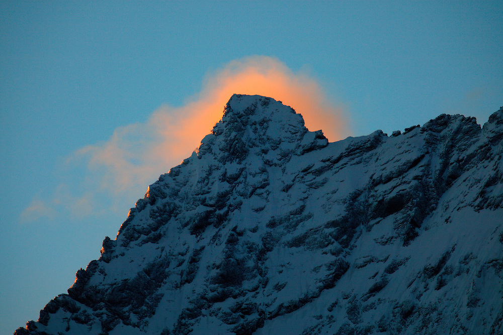 Russia, Caucasus. Teberdinsky biosphere reserve. First light on snow-covered mountain. Near Dombay.