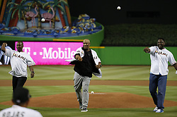 April 10, 2017 - Miami, FL, USA - From left, Edgar Renteria, Livan Hernandez and Charles Johnson, members of the 1997 World Champion Marlins team, during the ceremonial first pitch before the start of the Miami Marlins' home opener, against the Atlanta Braves, at Marlins Park in Miami on Tuesday, April 11, 2017. (Credit Image: © David Santiago/TNS via ZUMA Wire)