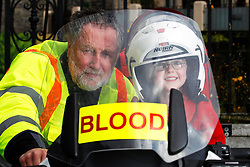No fee for Repro: 02/01/2013 .Pictured at the launch of Blood Bike East is Sarah Harding (6) from Mullingar with volunteer rider Paul Cooper. Blood Bike East is a charitable organisation that delivers blood & medical products by motorbike between hospitals in Leinster free of charge. It is an entirely volunteer run organisation and Blood Bike East riders are highly trained and can safely negotiate traffic where large vehicles would be unable to do so, unless an emergency blue light vehicle is taken off an already overstretched service. DoneDeal's recent donation of ?32,309 facilitated the purchase of additional motorcycles and their maintenance which was key to today's launch that sees the service roll out across all of Leinster. Pic Andres Poveda